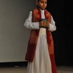 a little Parsi boy in traditional attire